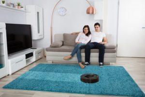 Aspirador en alfombra del salón